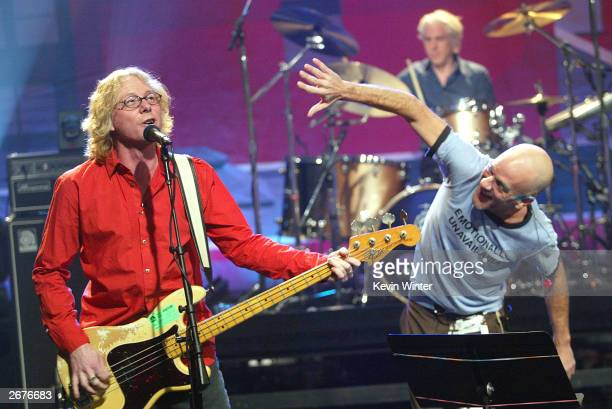 M with bass player Mike Mills and singer Michael Stipe perform on 'The Tonight Show with Jay Leno' at the NBC Studios on October 28 2003 in Burbank...