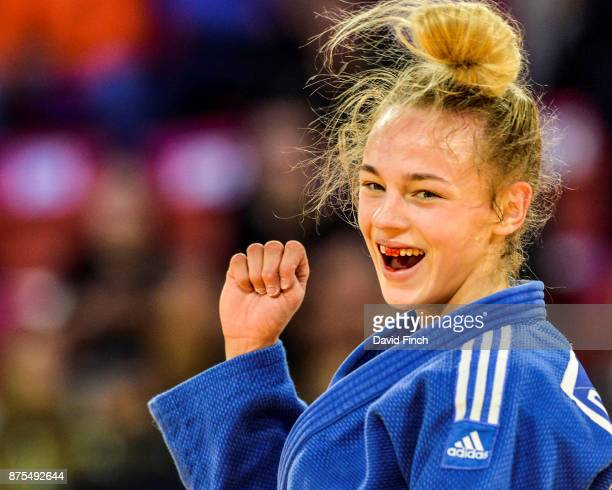 With blood on her front teeth seventeen year old Daria Bilodid of Ukraine celebrates winning the u48kg gold medal during The Hague Judo Grand Prix at...