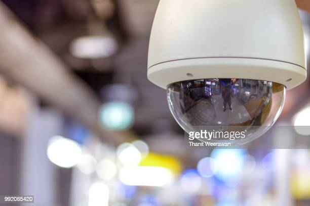 cctv with blur background, dome cctv camera - business security camera stock pictures, royalty-free photos & images