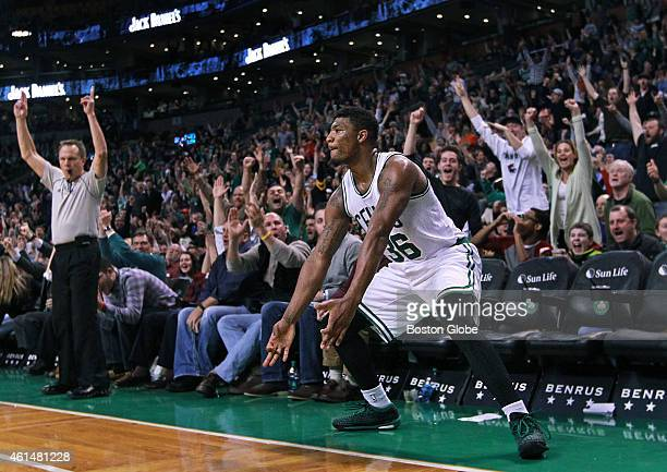 With Boston clinging to a one point lead late in the fourth quarter guard Marcus Smart defended by the Pelicans Tyreke Evans hit a huge three pointer...