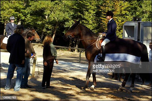 With brother Andrea coach Thierry Rozier and Albina of Boisrouvray best friend of her mother Princess Caroline in Barbizon France on September 29 2002