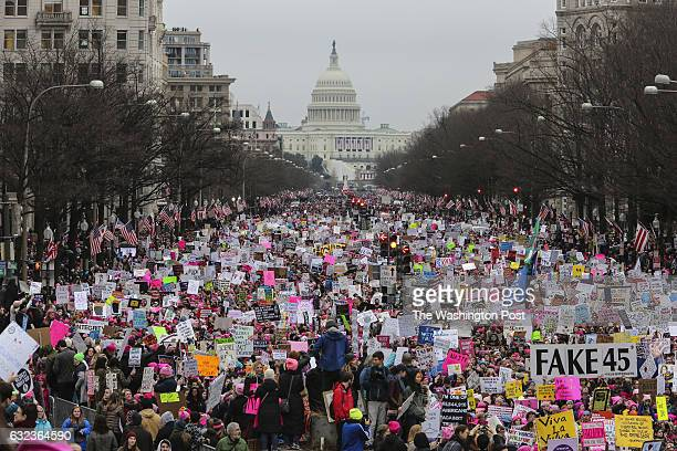 With Capitol Hill in the background a crowd fills the streets on Washington during the Women's March on January 21 2017