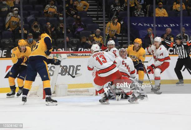 With Carolina Hurricanes goalie Petr Mrazek out of position, Nashville Predators center Matt Duchene tries to deflect the puck into the goal during...