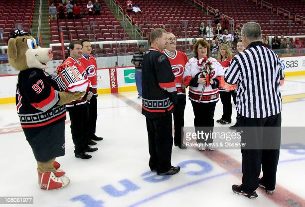 With Carolina Hurricanes mascot Stormy left serving as ringbearer and Ron the Ref Biscotti right presiding Alain Taylor left center and Monica Ludlum...