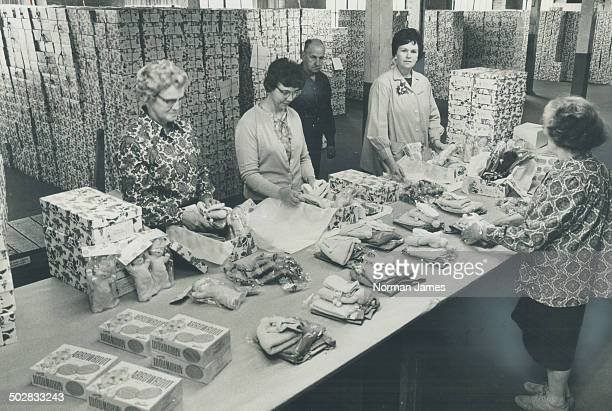 With Christmas so close The Star Santa Claus Fund warehouse on Richmond St W is a beehive of activity as workers pack boxes for distribution to...