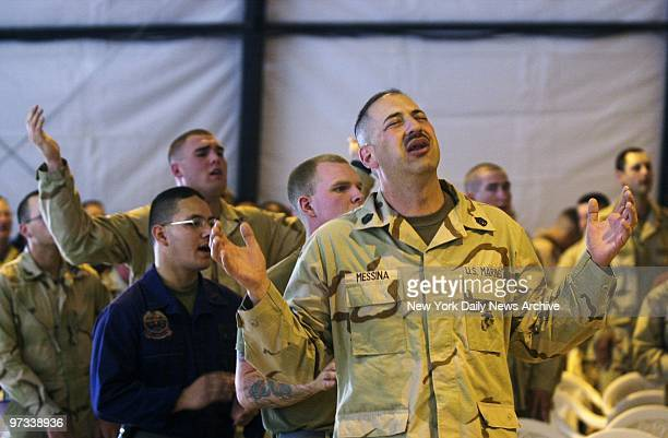 With combat looming Protestant Marines pray during services this morning at a US base near Kuwait's Iraqi border In a sweaty messhalltentturnedchurch...