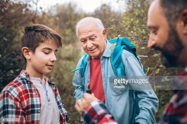 With dad and grandfather in forest