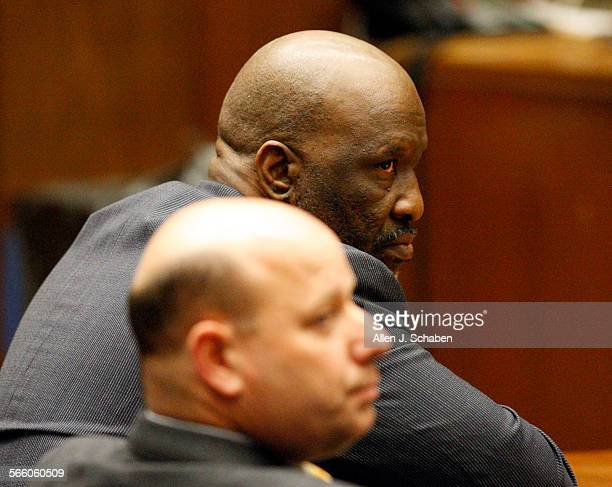 With defense attorney Sean McDonald in foreground listening Ernest V Nelson in focus is found guilty of conspiracy to commit grand theft embezzlement...