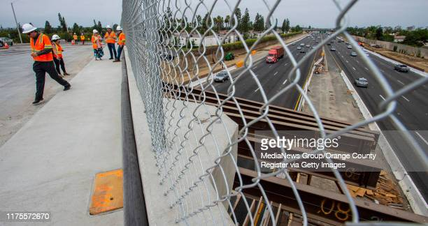 With falsework still in place, traffic on the 405 freeway passes under the new Slater Avenue bridge in Fountain Valley on Wednesday, August 28, 2019....