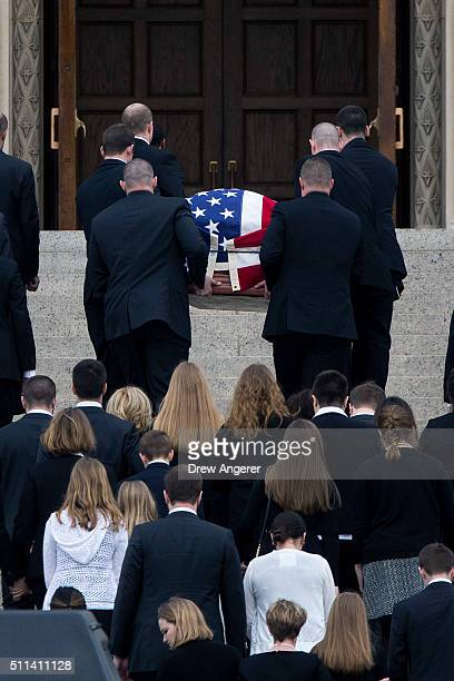 With family members following behind pallbearers carry the casket of late Supreme Court justice Antonin Scalia up the steps of the Basilica of the...