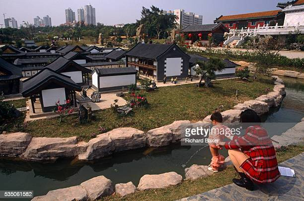With few visitors to see a young boy pees into the water surrounding a model town at the Splendid China model village the 30 hectares large tourist...