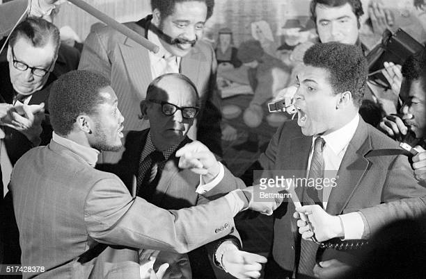 With fingers pointing Muhammad Ali , claiming he is the true champion, and Joe Frazier, the recognized heavyweight titleholder, engage in a shouting...