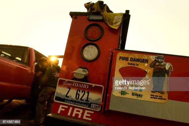 With fire danger high and a red flag warning in effect firefighters with Idaho Department of Lands prepare their trucks before heading out for the...