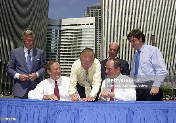 With Gov Pataki and New Jersey Acting Gov Donald DiFrancesco looking on Larry Silverstein signs on the dotted line to complete the deal in which the...