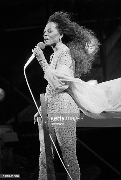 With hair and scarves blowing in the wind Diana Ross belts out a number during a concert in Central Park in 1983 About 800000 fans had gathered for...