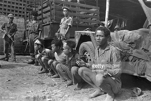 With hands tied behind their backs Khmer Rouge captives are guarded August 26th by Government soldiers armed with Russianmade rifles at Angkor Chey...