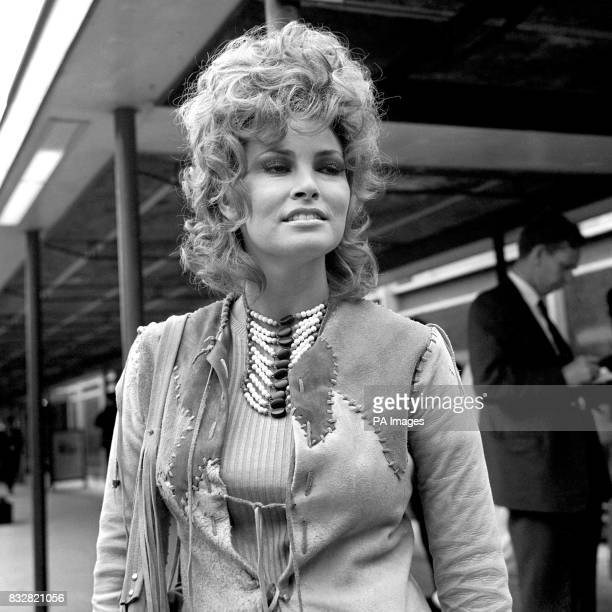 With her beaded thonged leather suit and bead necklace film actress Raquel Welch recalls her frontier days as she arrives at Heathrow Airport