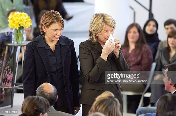 With her daughter Alexis by her side Martha Stewart wipes away a tear as she speaks to her employees at Martha Stewart Living Omnimedia Inc in...