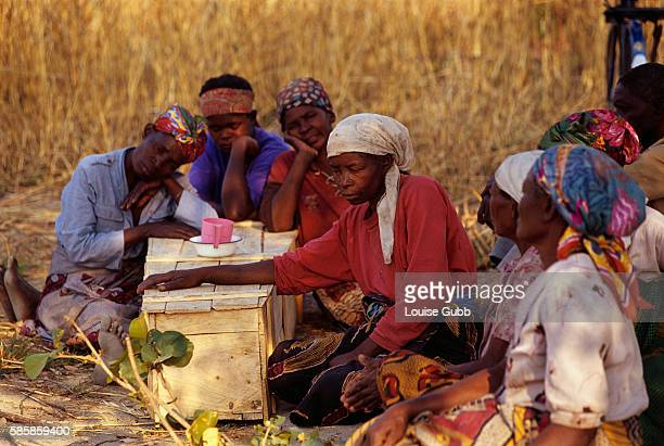 With her family gathered around her a woman mourns at the coffin of her daughter a victim of AIDS and mother to several children Seventy percent of...