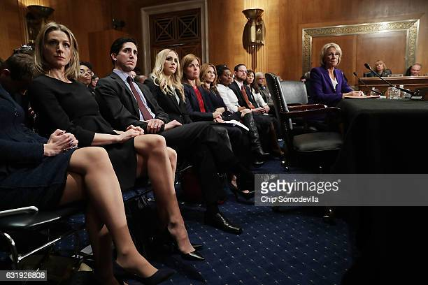 With her family sitting behind her Betsy DeVos Presidentelect Donald Trump's pick to be the next Secretary of Education testifies during her...
