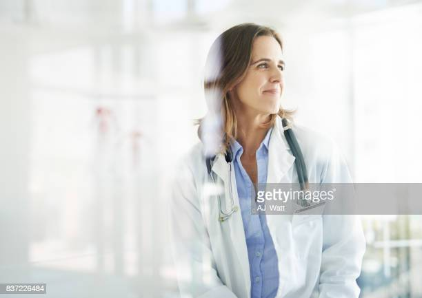 with her, good health is in sight - female doctor stock photos and pictures