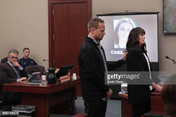 With her husband by her side Carrie Hogan delivers a victim impact statement at the sentencing hearing for Larry Nassar who has been accused of...