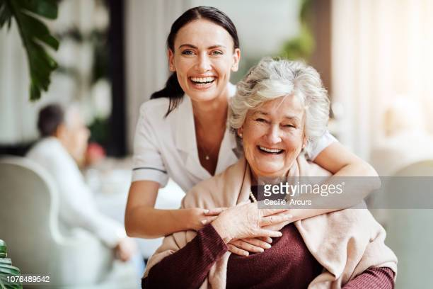 with her i'm not just a resident, i'm family - healthcare workers stock pictures, royalty-free photos & images