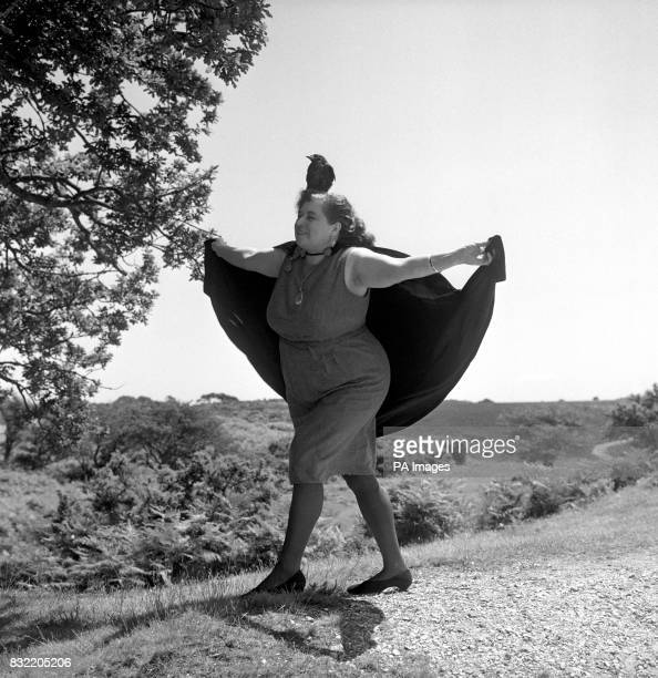 With her jackdaw Hotfoot Jackson perched on her head Sybil Leek the 'White Witch of Burley' spreads her cloak in a ritual dance in the New Forest...