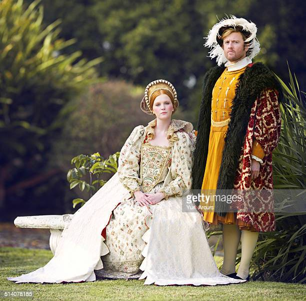 with her king by her side - koningschap stockfoto's en -beelden