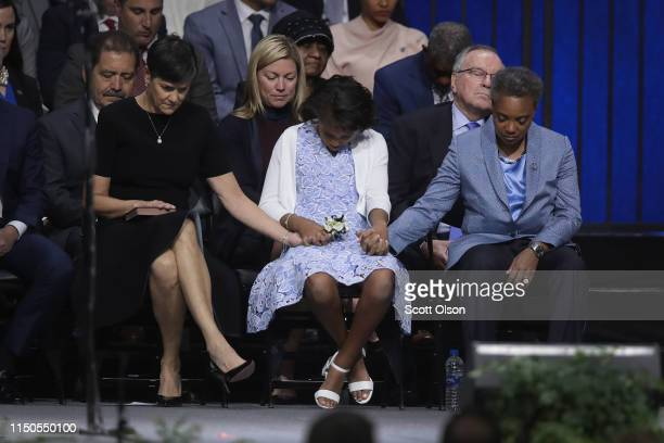 With her wife Amy Eshleman and daughter Vivian by her side Lori Lightfoot listens to a prayer during her inauguration ceremony at the Wintrust Arena...