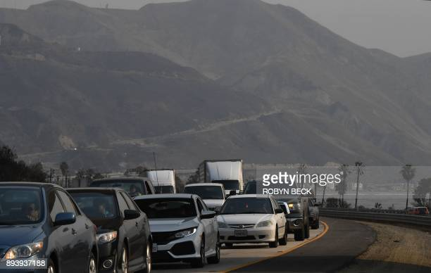With hills burnt in early days of the Thomas Fire in the background traffic on the 101 freeway near Seacliff California is at a standstill as a...