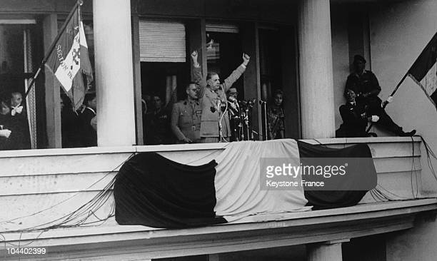 GAULLE with his arms raised in a victory symbol giving his celebrated statement from the balcony of the Algiers general government headquarters JE...