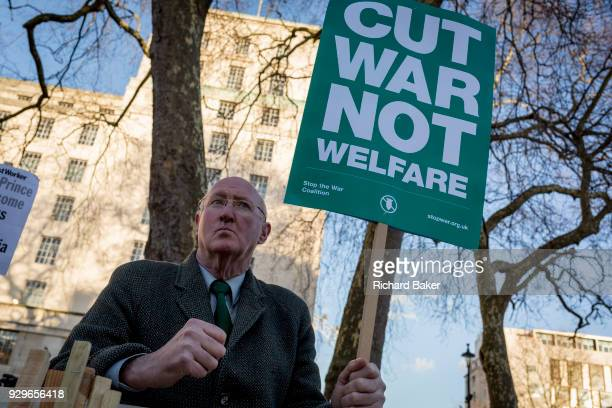 With his back to the Ministry of Defence main building in Whitehall an elderly gentleman protests about war not welfare in Whitehall before Saudi...