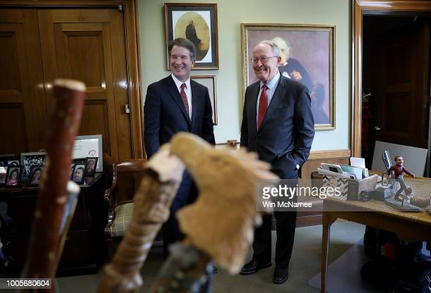 With his collection of walking sticks in the foreground Sen Lamar Alexander meets with Supreme Court nominee Judge Brett Kavanaugh in his office on...