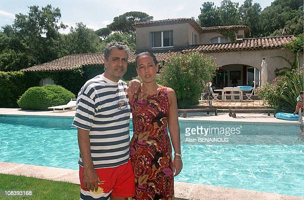 With his daughter Jocya in Saint-Tropez, France on August 01, 2000.