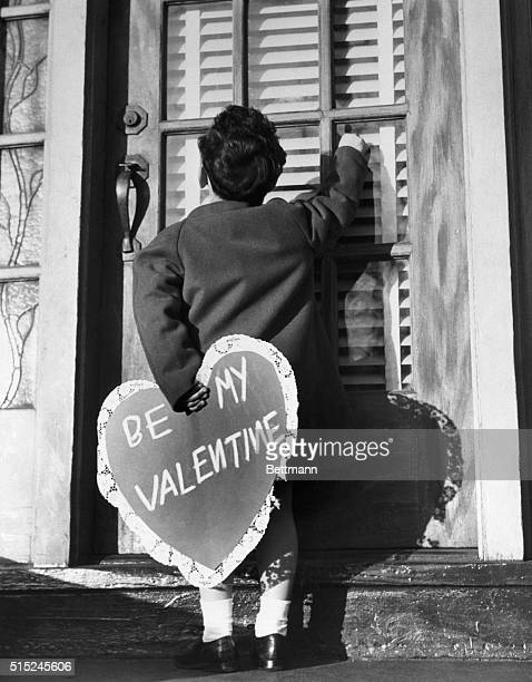 With his heart in his hand little Johnny McBride of the 'Juvenile Jury' prepares to deliver a valentine surprise to his sweetheart According to...