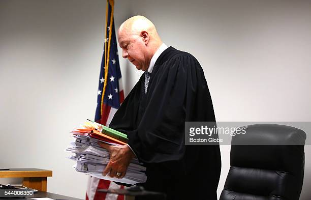 With his hefty stack of documents and notes Judge George Phelan leaves the bench at the end of the day Attorneys representing various factions of...