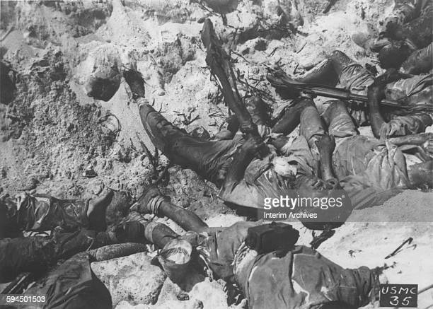 With his rifle still in hand a dead Japanese soldier lies in a trench after having committed suicide on Namur Island Kwajalein Atoll Marshall Islands...