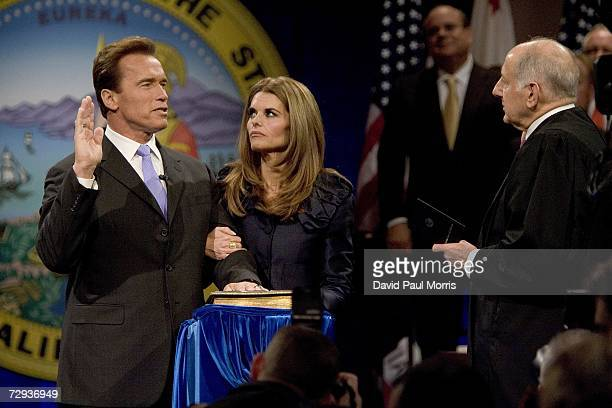 With his wife Maria Shriver by his side California Governor Arnold Schwarzenegger is sworn into office by Supreme Court Chief Justice Ronald George...