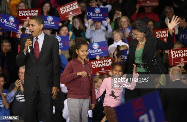 With his wife Michelle and daughters Malia and Sasha by his side Democratic Presidential hopeful Senator Barack Obama speaks to voters during a rally...