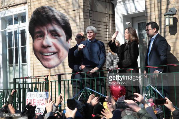 With his wife Patti by his side former Illinois Governor Rod Blagojevich greets people gathered in front of his home as he steps out to address the...