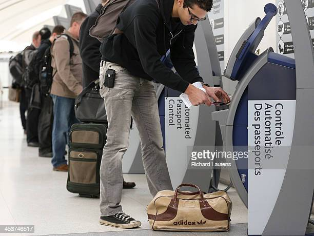 With holiday travel set to increase Pearson Airport and US Border and Customs officials invite media to see 40 automated processing kiosks that...