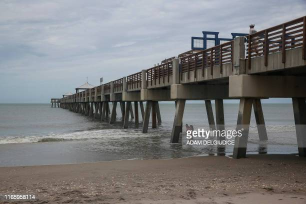 With Hurricane Dorian now past and the southern Florida area largely unaffected, people return to the Juno Beach Pier to enjoy the beach on September...