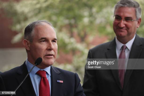 With Indiana Gov. Eric Holcomb by his side, U.S. EPA Administrator Scott Pruitt makes a statement to the media after meeting residents from and...