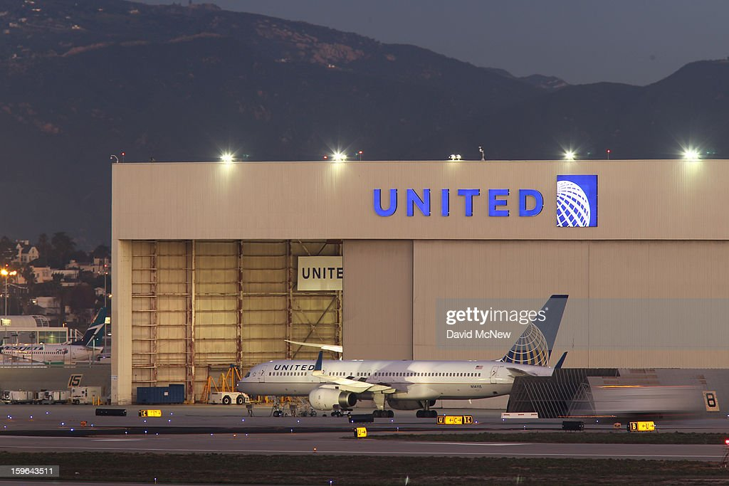 With its Boeing 787 Dreamliner jets grounded, a Boeing 757 jet is parked near a United Airlines hanger before a new day of service as United Airlines carries on with its fleet of 777s at Los Angeles International Airport (LAX) on January 17, 2013 in Los Angeles, California. The Federal Aviation Administration has grounded all U.S.-registered Boeing 787 Dreamliner jets for the repair of batteries believed to be linked to a fire risk following a number of related 787 aircraft incidents this month.