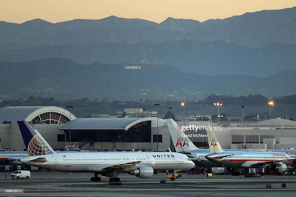 With its Boeing 787 Dreamliner jets grounded, a Boeing 757 takes off with the Hollywood sign in the distance as United Airlines carries on with its fleet of 777s at Los Angeles International Airport (LAX) on January 17, 2013 in Los Angeles, California. The Federal Aviation Administration has grounded all U.S.-registered Boeing 787 Dreamliner jets for the repair of batteries believed to be linked to a fire risk following a number of related 787 aircraft incidents this month.