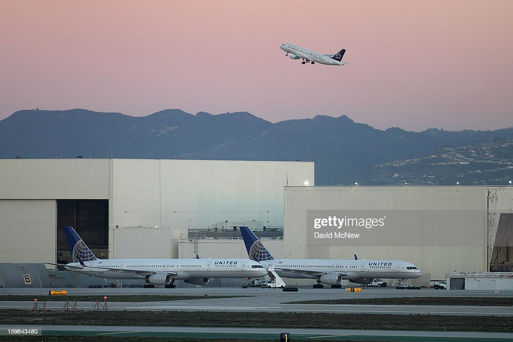 With its Boeing 787 Dreamliner jets grounded, Boeing 757 jets are parked on the tarmac before a new day of service as United Airlines carries on with its fleet of 757s at Los Angeles International Airport (LAX) on January 17, 2013 in Los Angeles, California. The Federal Aviation Administration has grounded all U.S.-registered Boeing 787 Dreamliner jets for the repair of batteries believed to be linked to a fire risk following a number of related 787 aircraft incidents this month.