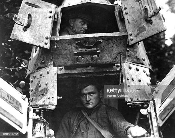 With its hatches open an American skipper and gunner are visible sitting in close quarters inside a whippet tank northwest of Verdun France 1918 US...