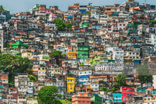 "with its vibrant colored buildings and shacks, rocinha has become the largest slum in brazil and a tourist attraction. called ""favela"" in portuguese it has a population of 70,000 dwellers - south america stock pictures, royalty-free photos & images"