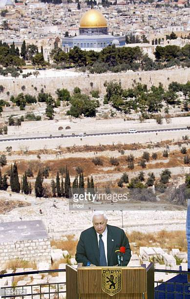 With Jerusalem and Islam's Dome of the Rock in the background, Israeli Prime Minister Ariel Sharon inaugurates a promenade in memory of late Tourism...